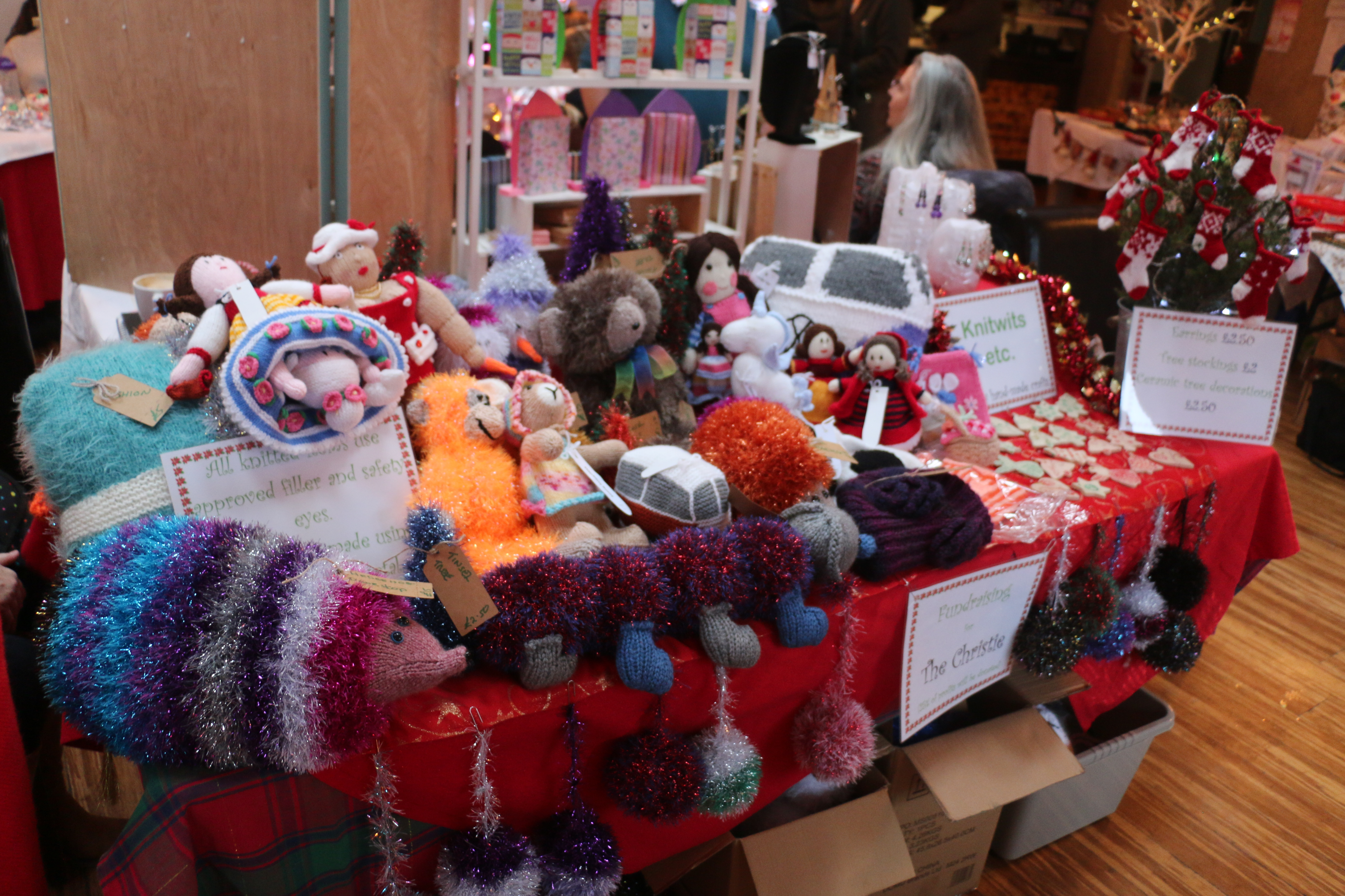 Stall of Knitwits full of knitted toys and fashion accessories