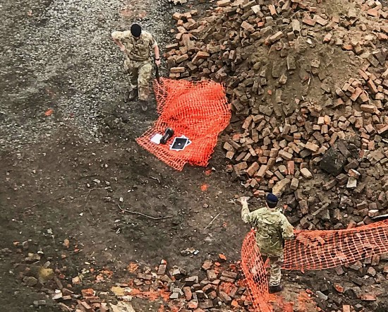 Specialist military officers find unexploded tank cartridge device in Spinningfields