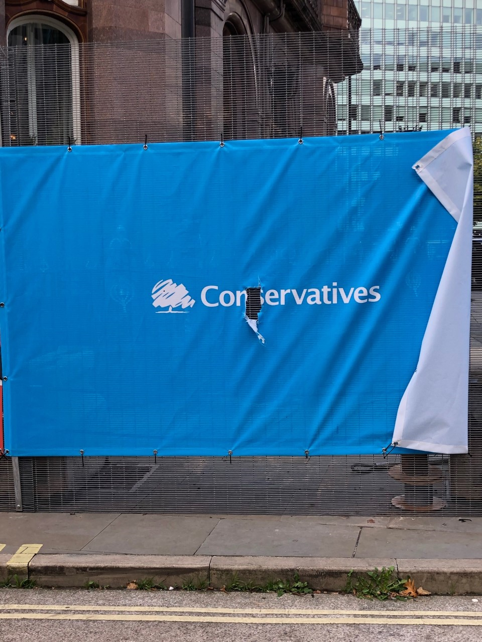 Ripped Conservative party banner