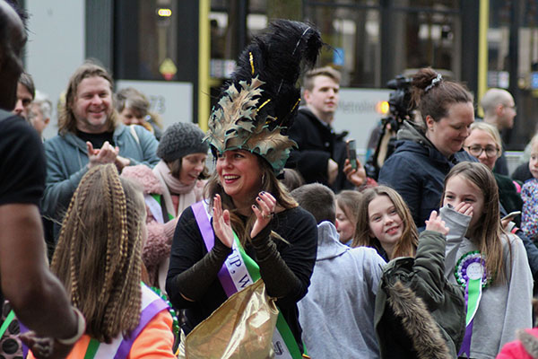 Dancers and children cheer after the performances end.