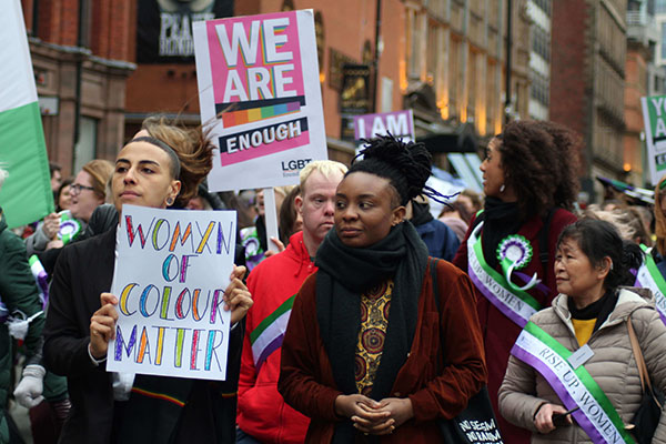 Women of colour matter, sign held by Chloe from Rainbow Noir